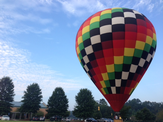 Watched this hot air balloon land just outside my neighborhood on a walk last week.
